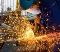 men at work grinding steel